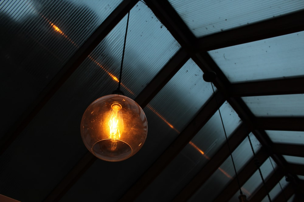 clear glass pendant lamp hanging in wall