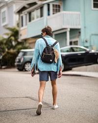 man walking wearing blue dress shirt