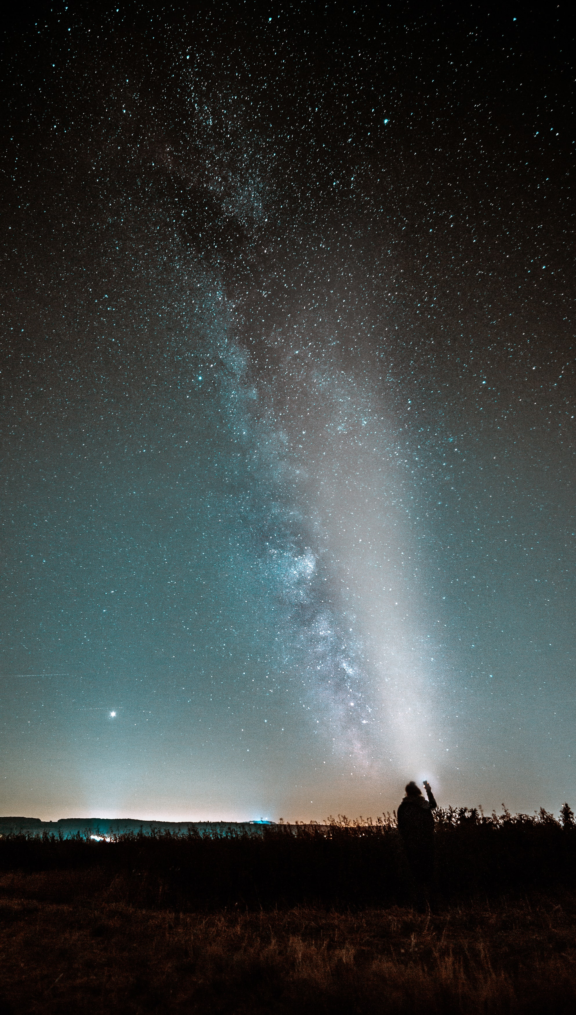 silhouette photography of person watching milky way in sky