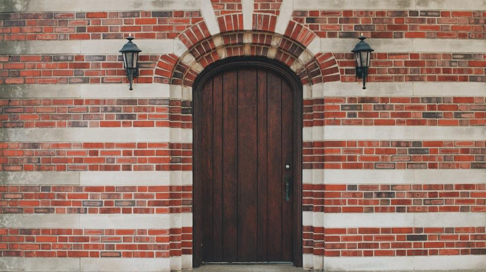 brown wooden door left closed