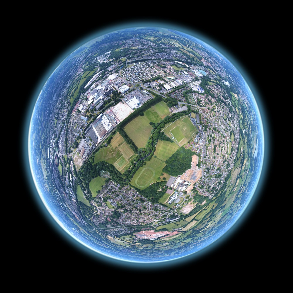 fish-eye aerial shot of buildings and trees