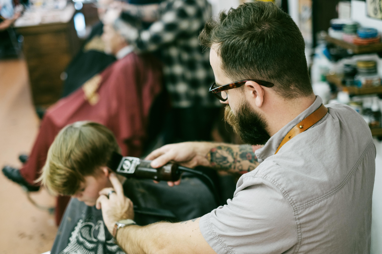 man shaving the boy's hair