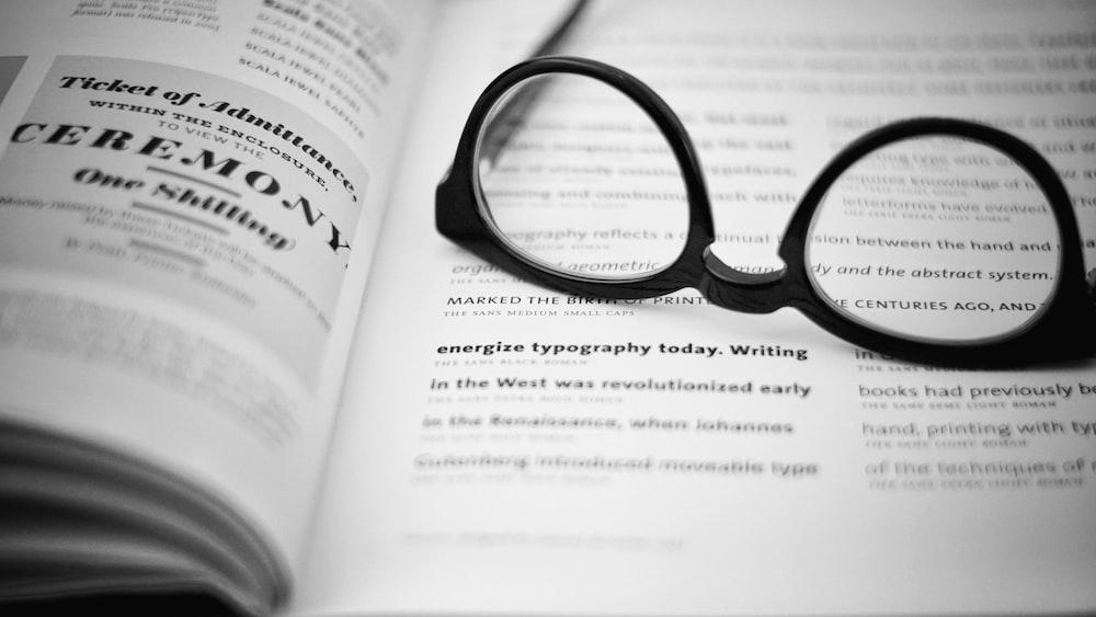 black eyeglasses on book body