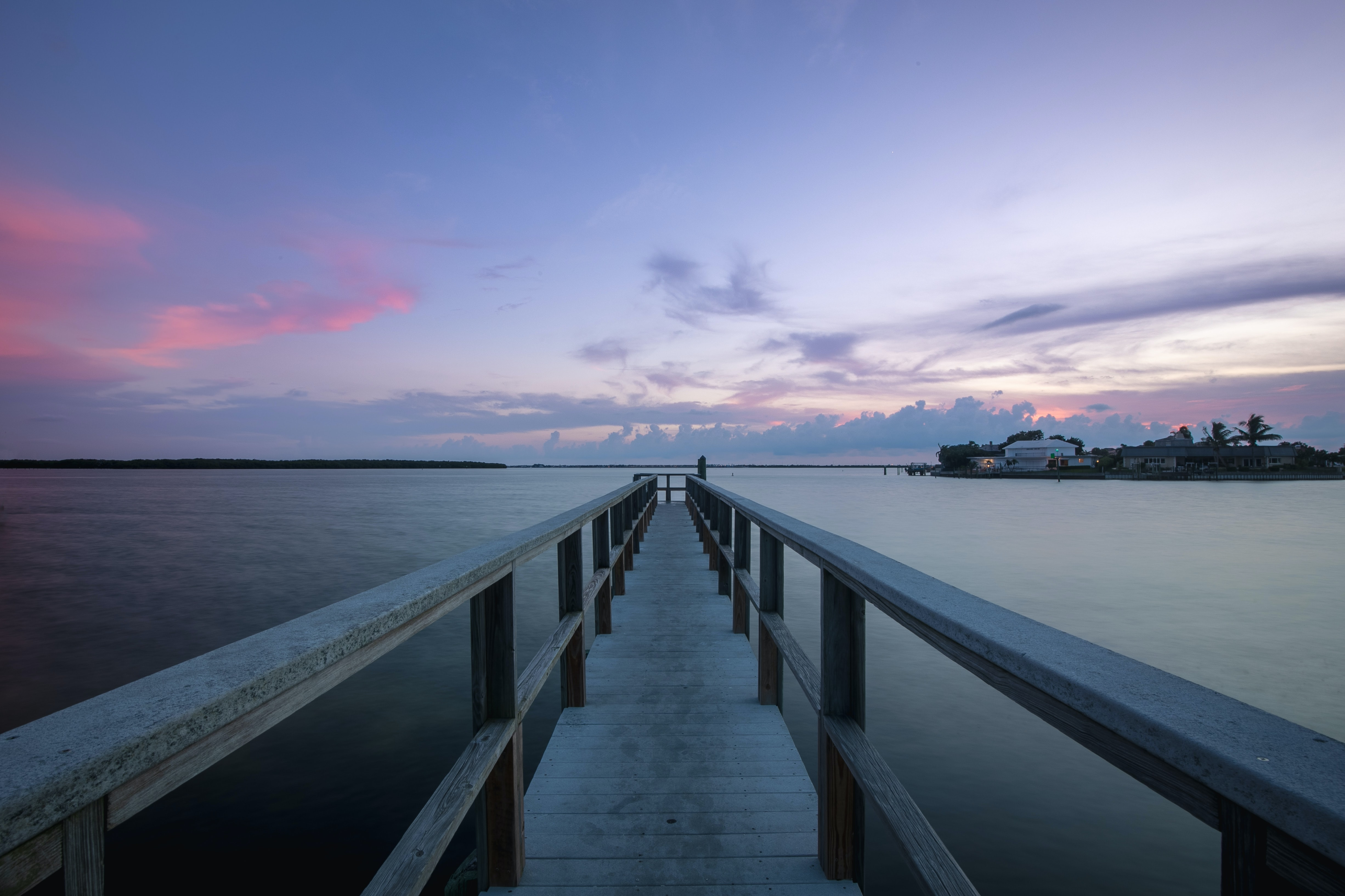 gray wooden beach dock during calm waters