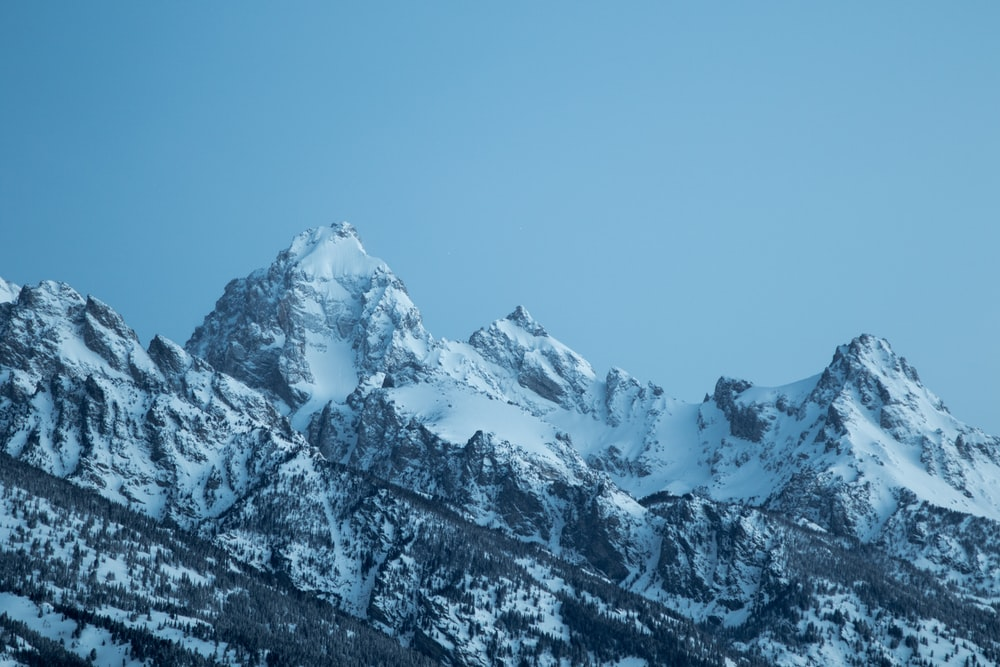 landscape photography of mountains covered by snow