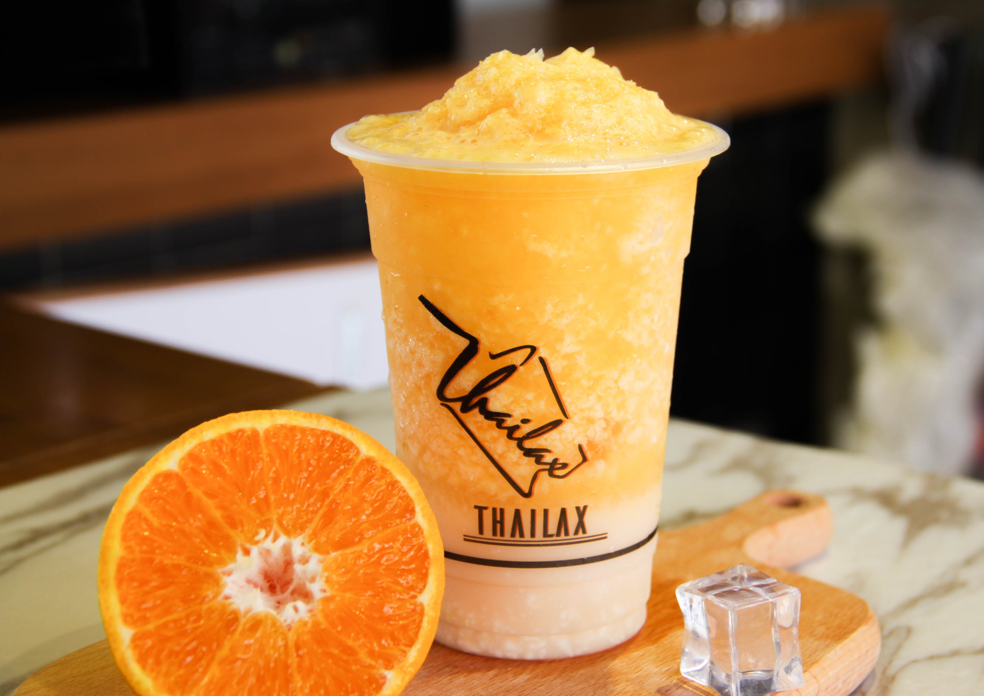 orange Thailax lemon shake on wooden chop board