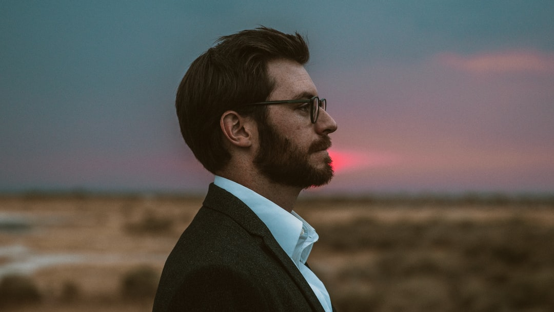 Man stares and he glasses and has beard, nice