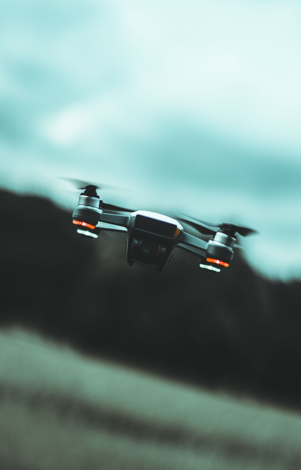 black quadcopter drone flying on the air