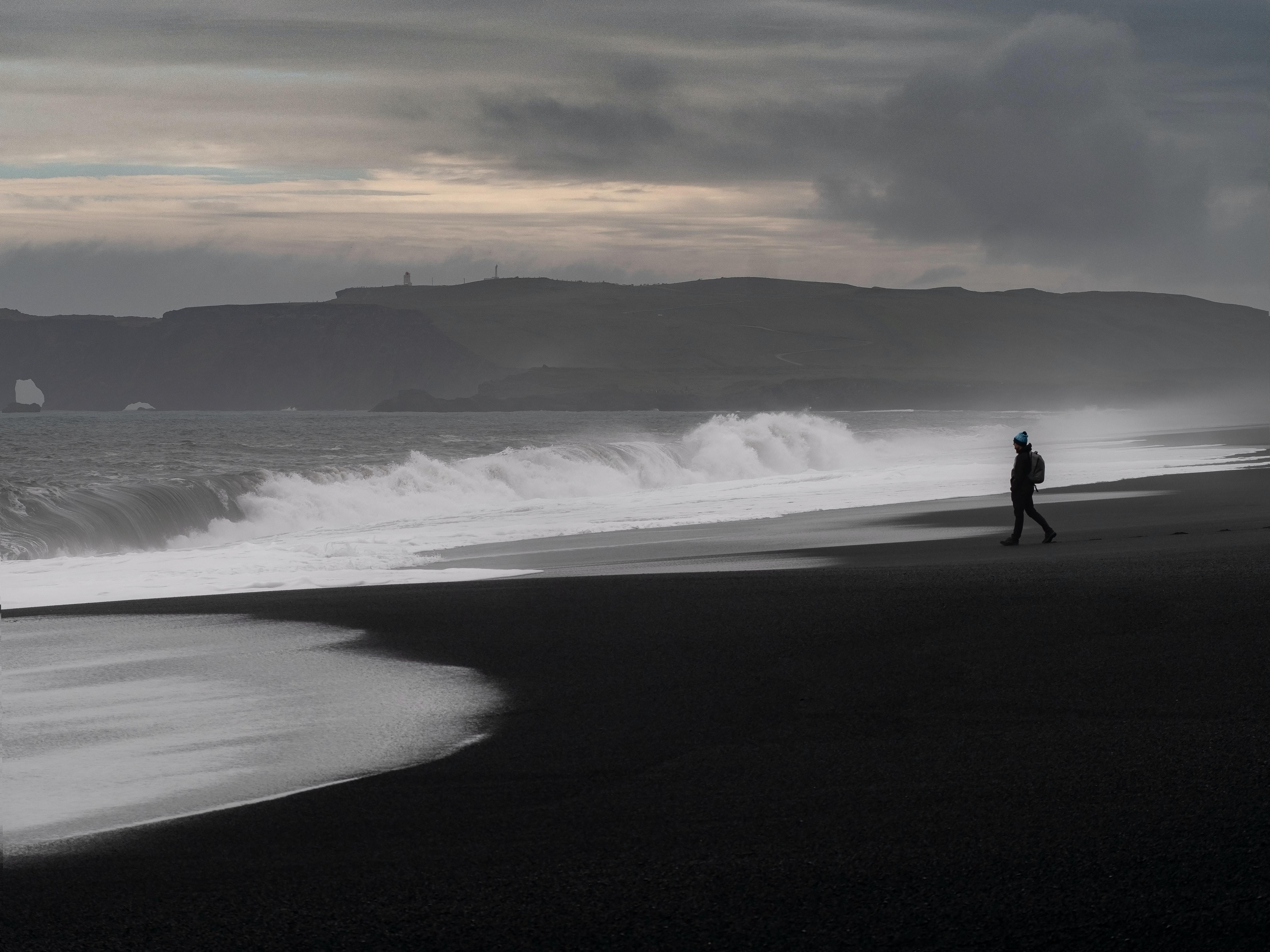 silhouette photo of person on seashore