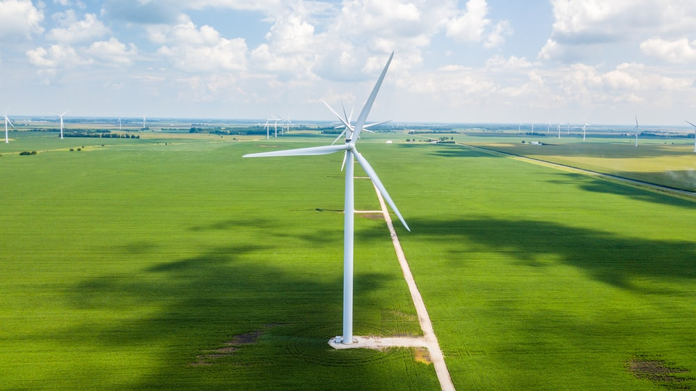 landscape photo of wind turbine surrounded by grass