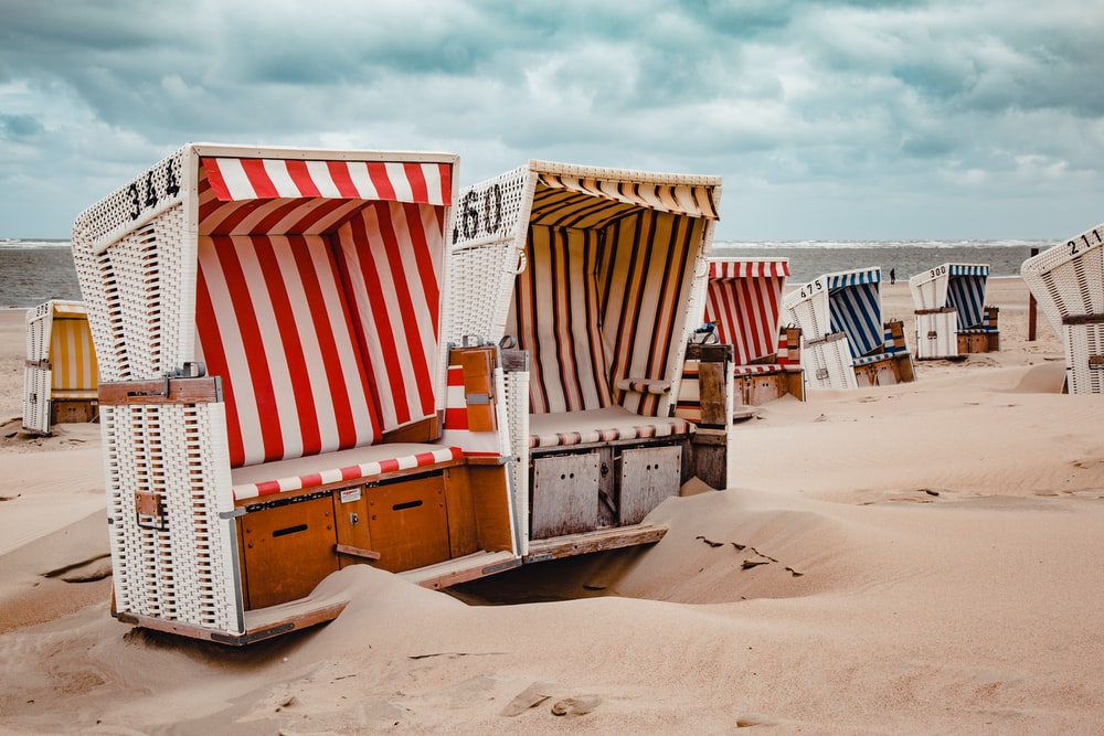 assorted-color chairs on shore during daytime