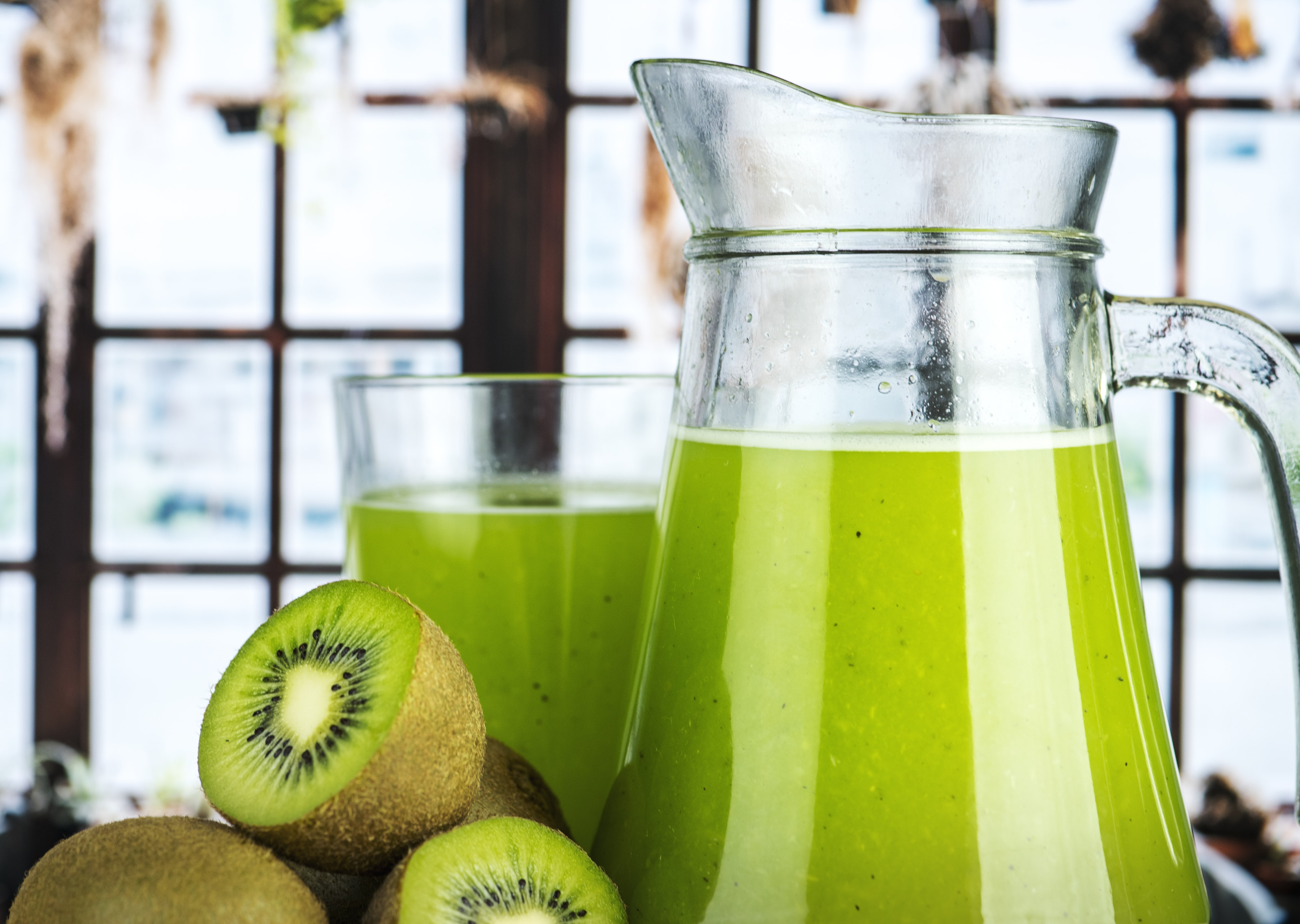 glass pitcher filled kiwi juice