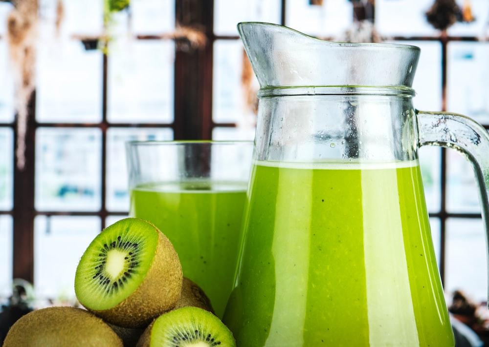 glass pitcher filled kiwi juice