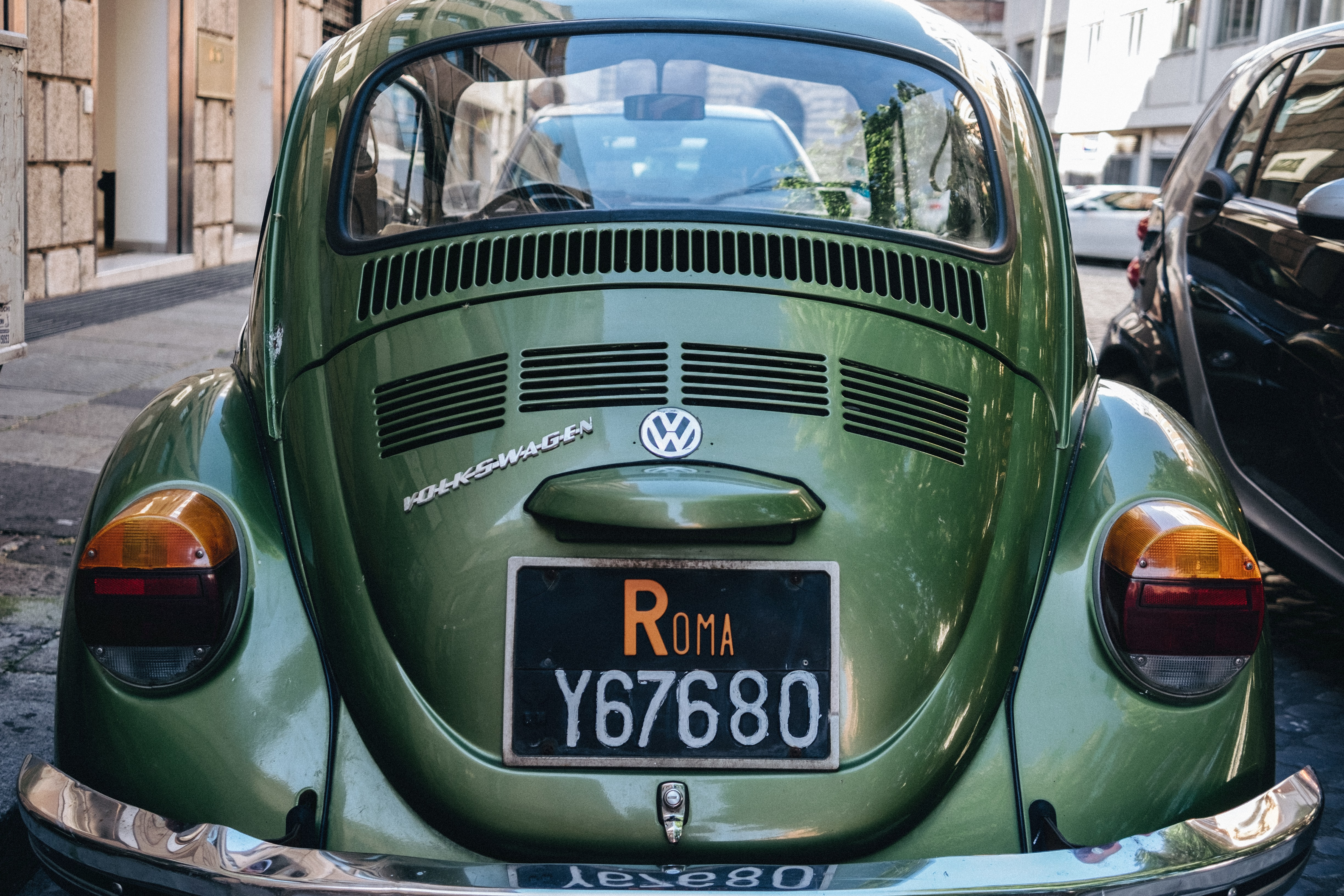 green Volkswagen Beetle car