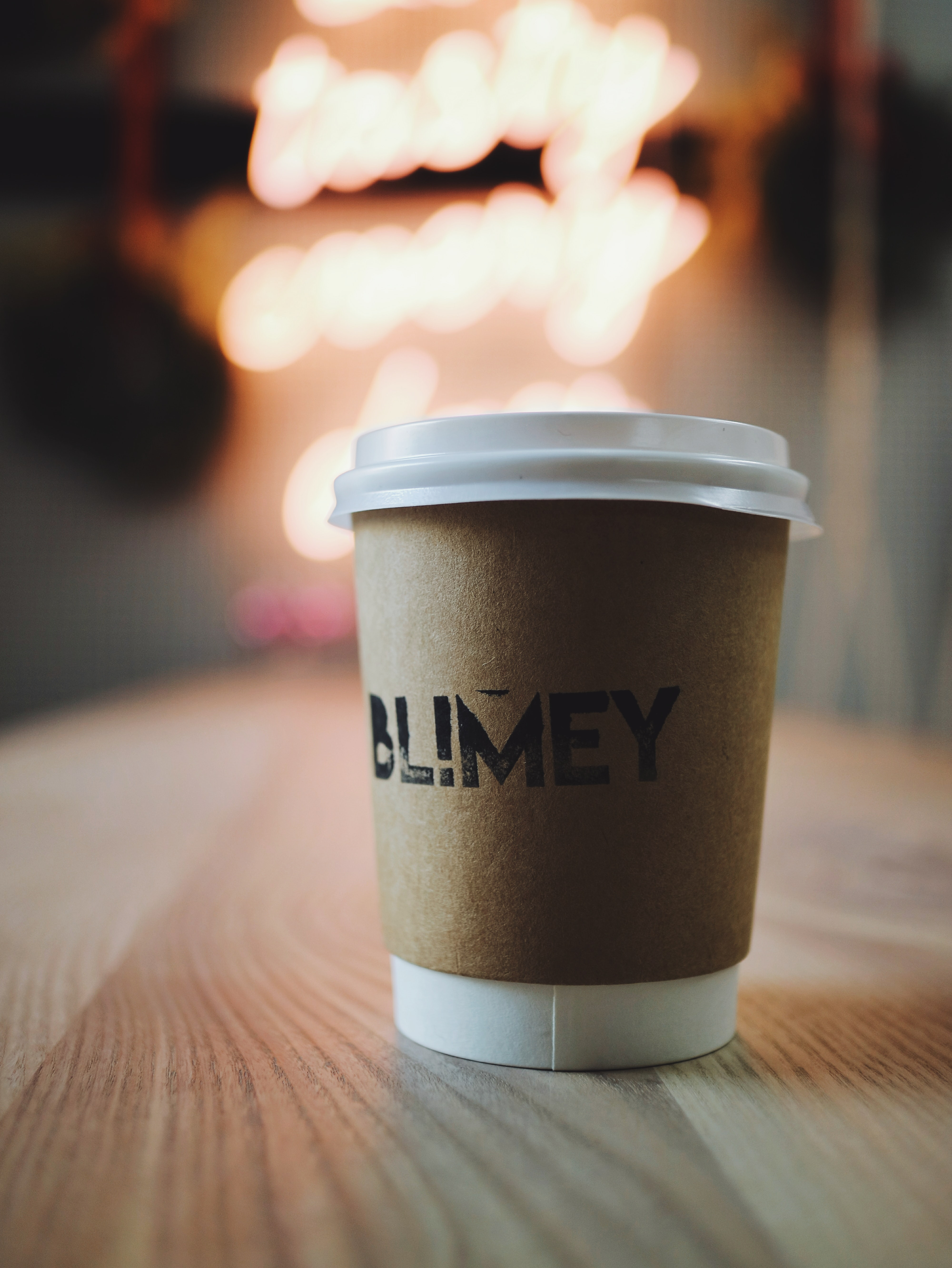 selective focus photography of white disposable cup