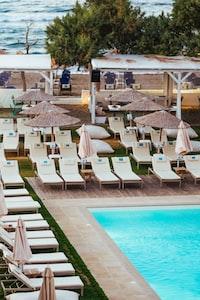 white sun lounge beside pool