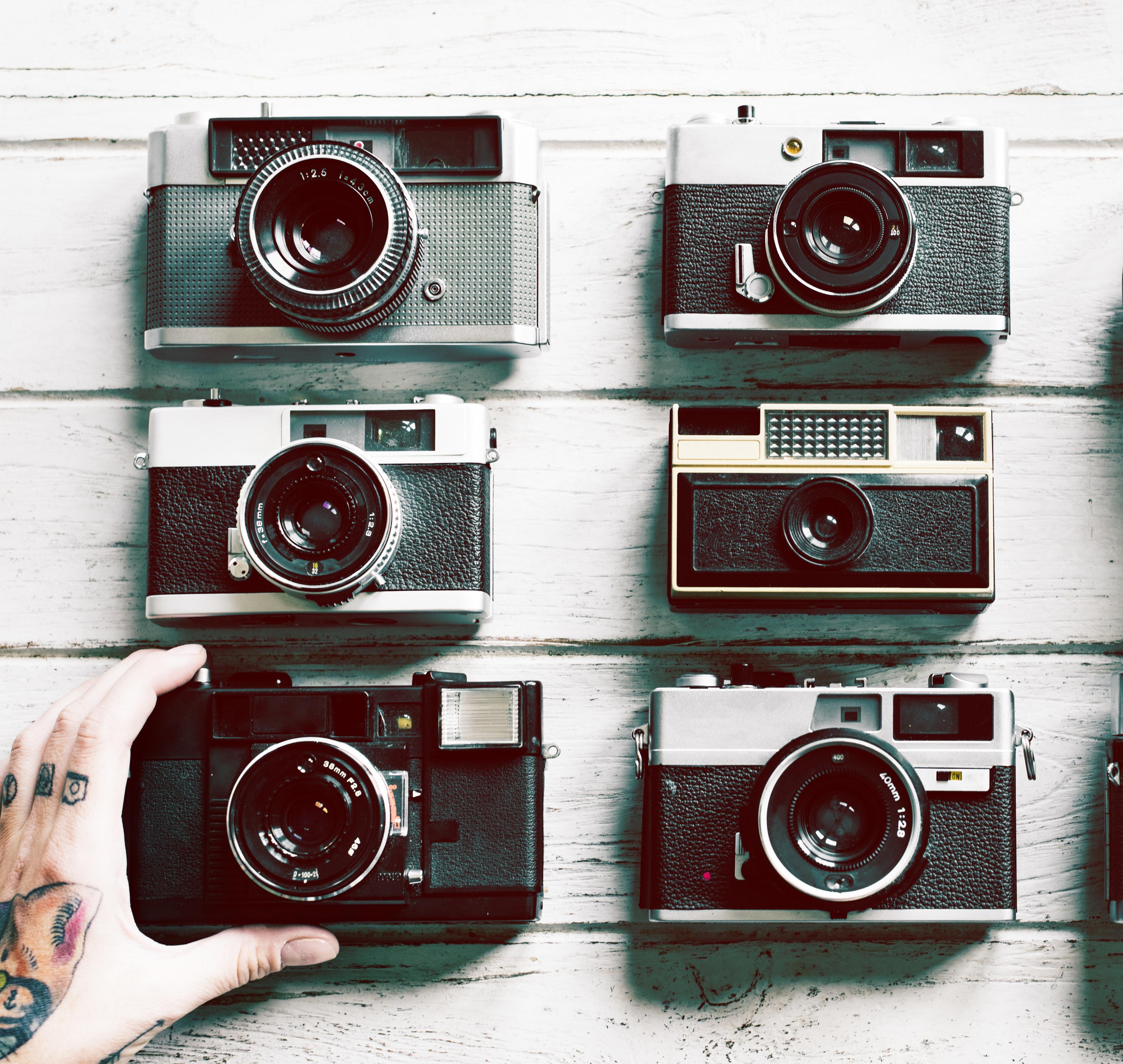 six black-and-gray cameras
