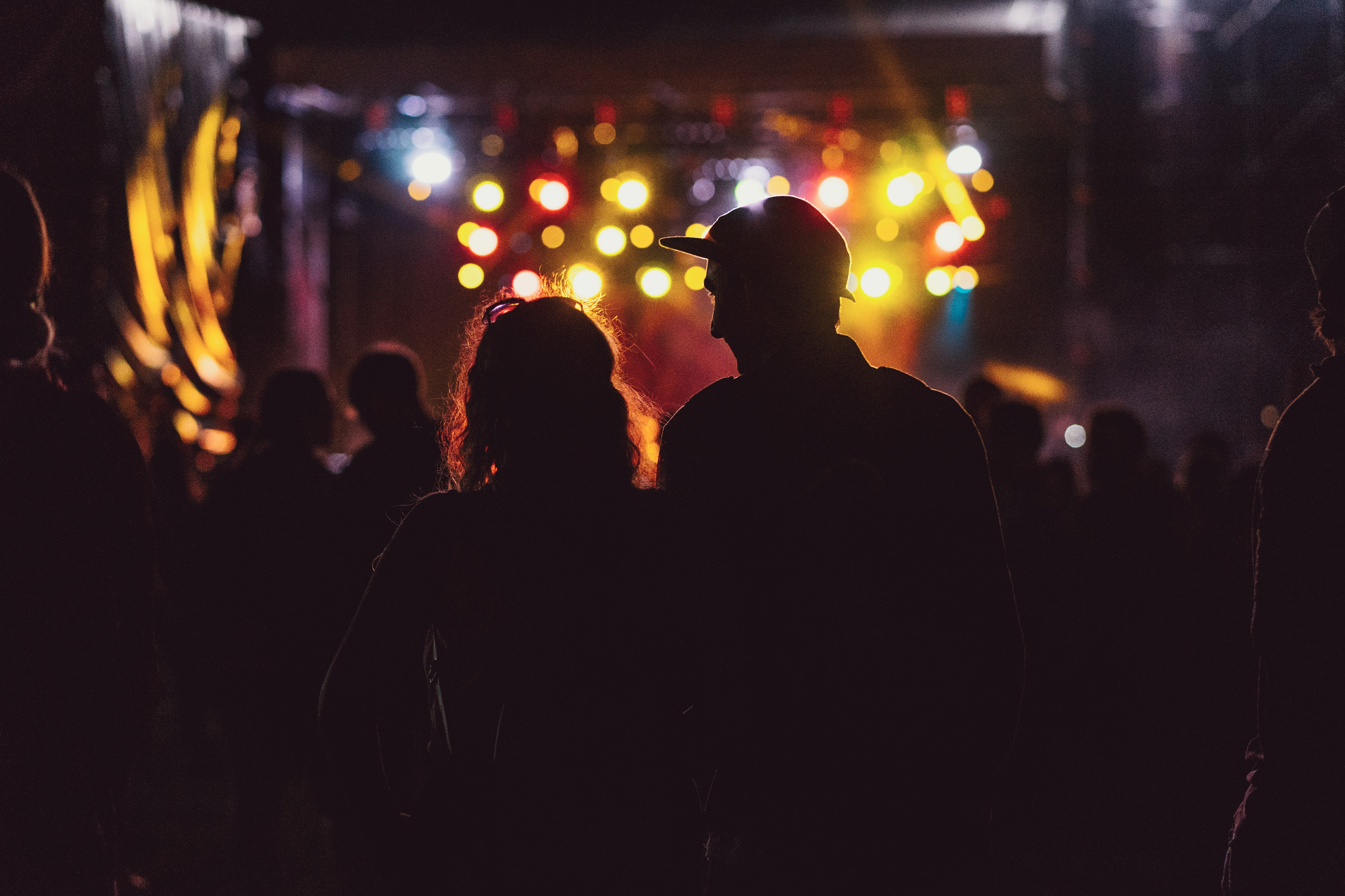 silhouette photo of a man and a woman on the stage