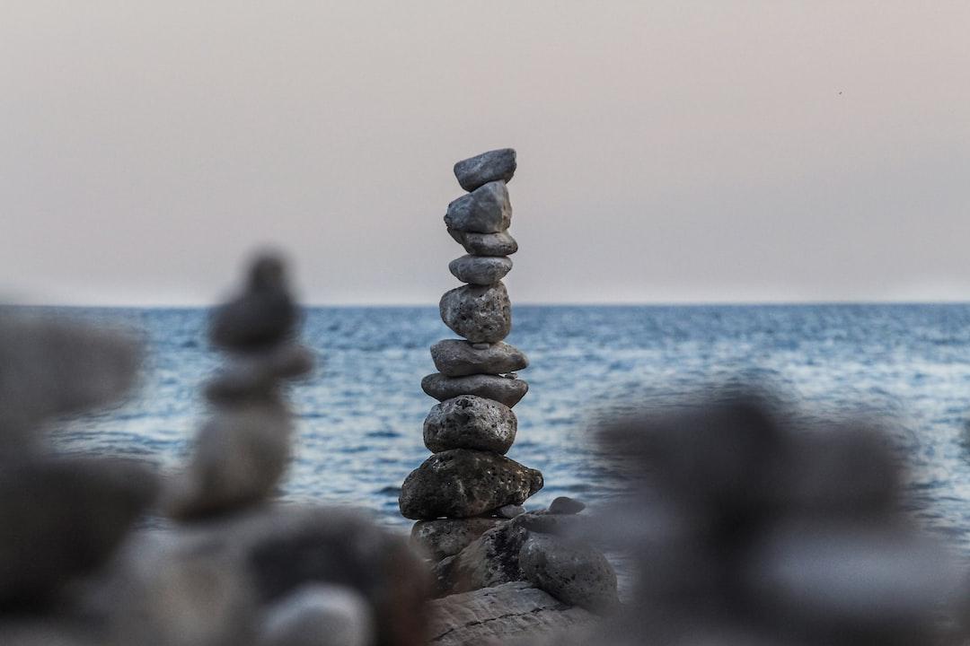 A beautiful beach at Rovinj, Istria, full of rock balancing sculptures.  Shot by https://www.instagram.com/valentinsalja