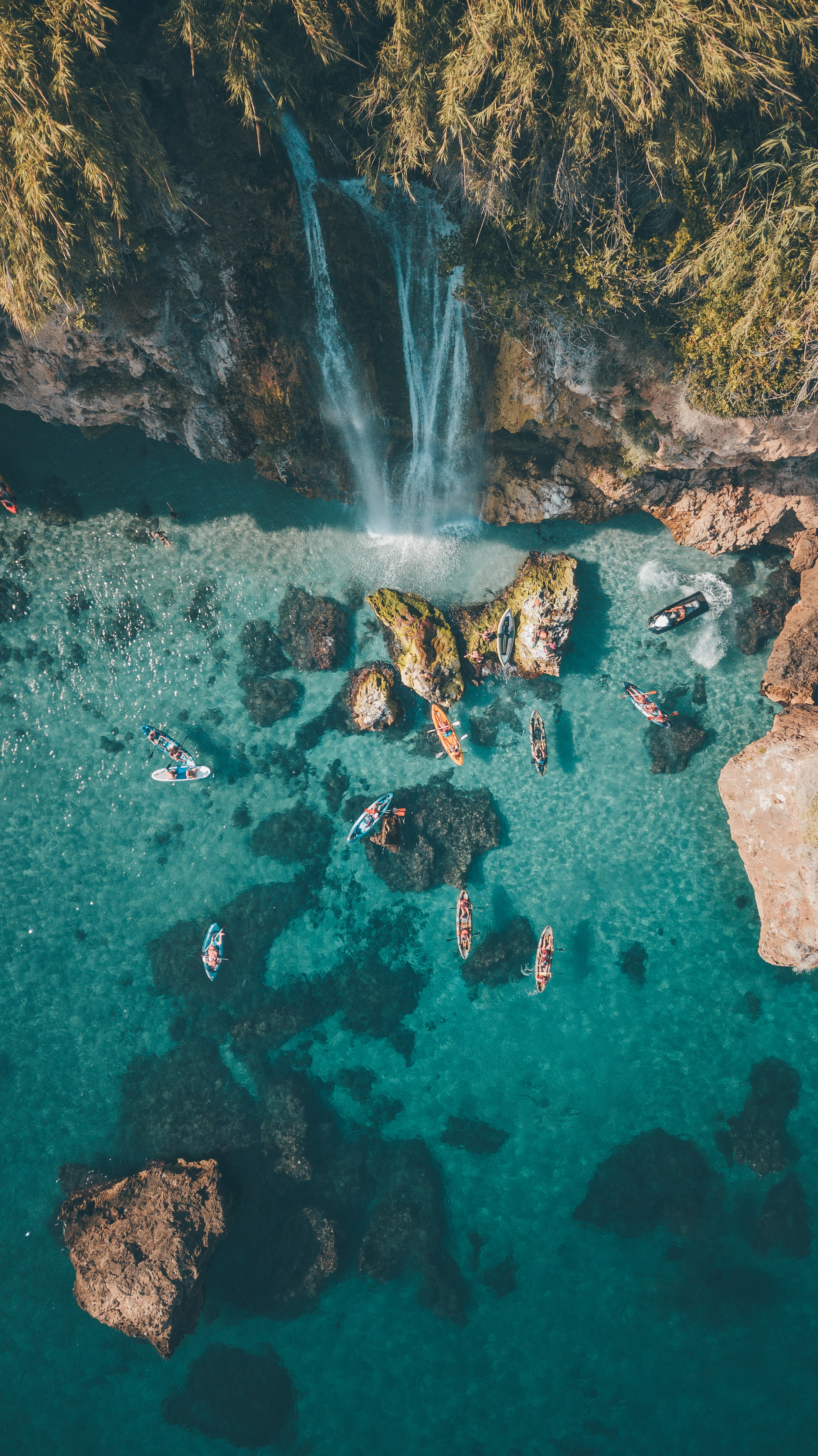 aerial photography of waterfalls and ocean