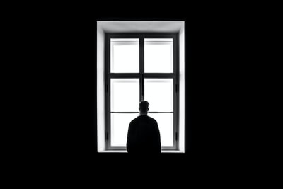 man standing in front of the window sorrow teams background