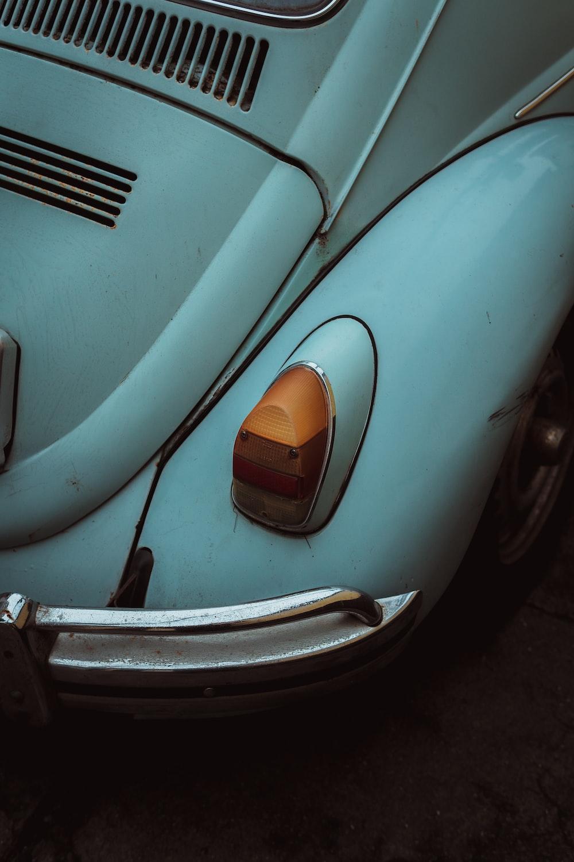 white beetle on road