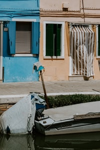 Colourful houses of Burano with boats moored