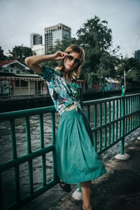 women's teal and white cap-sleeved tie-down blouse and skirt