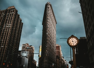 low-angle photography of buildings under cloudy sky