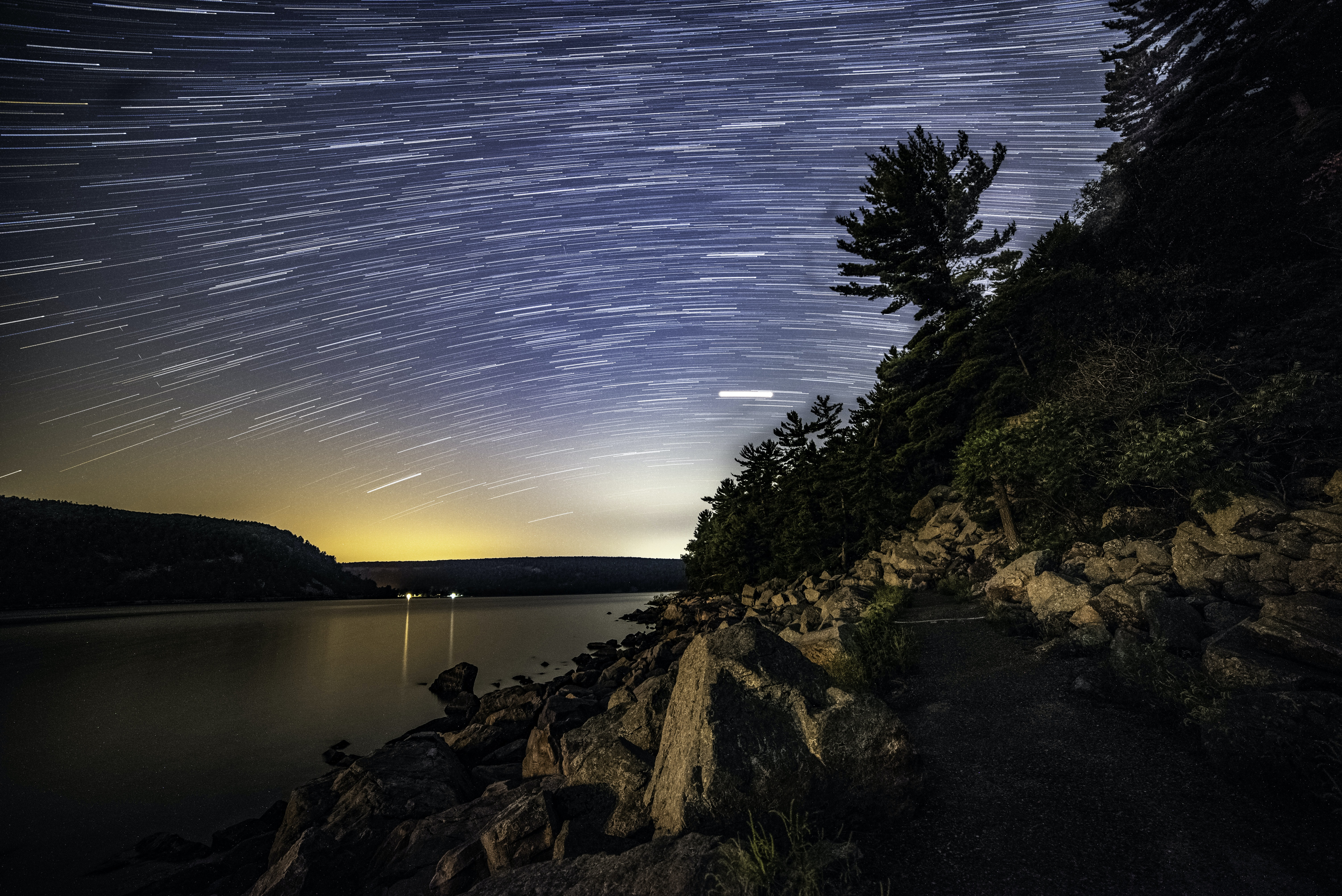 time-lapse photography of stars above body of water