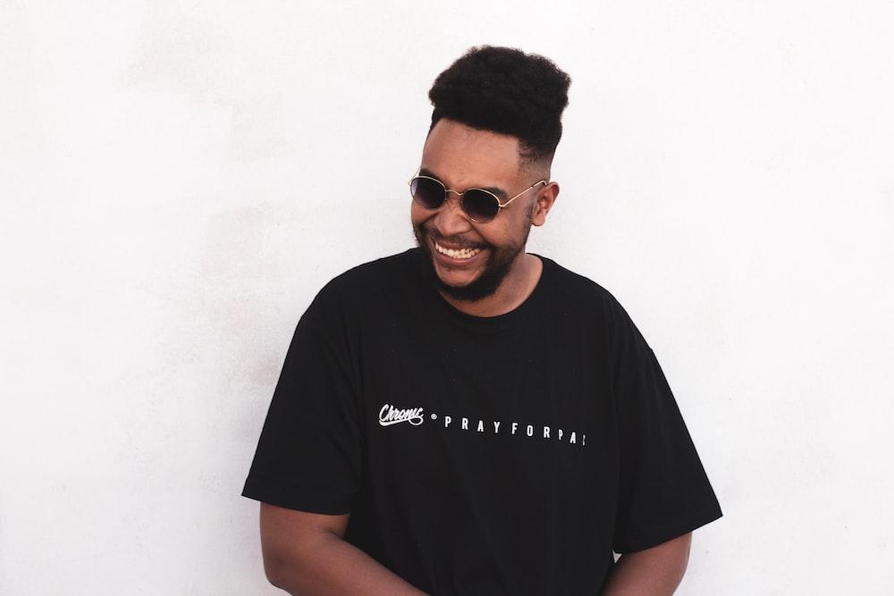 smiling man wearing black t-shirt