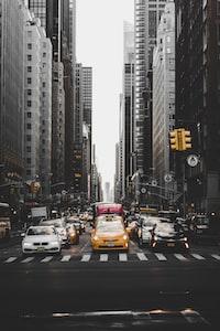 cars in between buildings