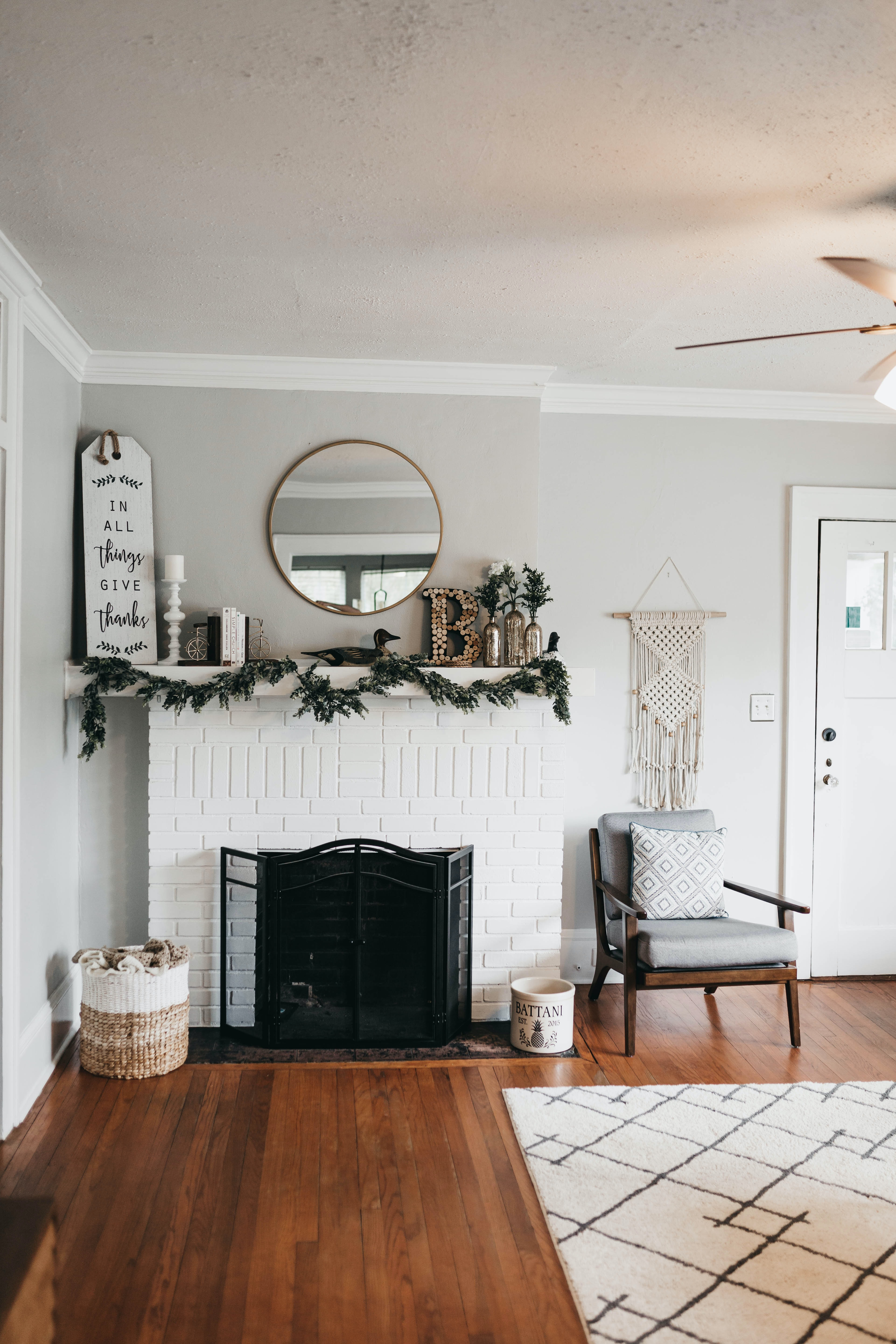 white fireplace mantel with decors