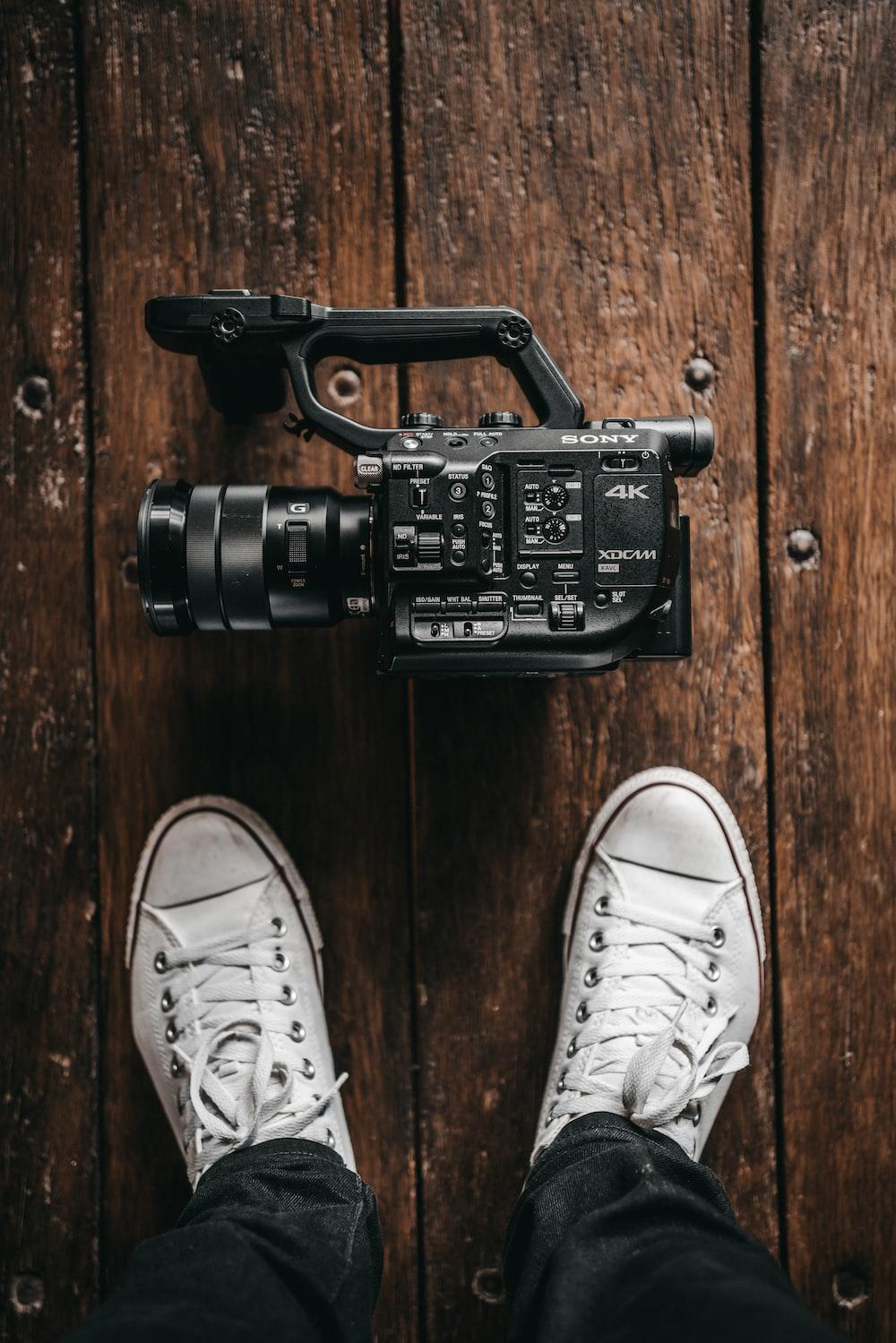 black Sony videocamera on floor