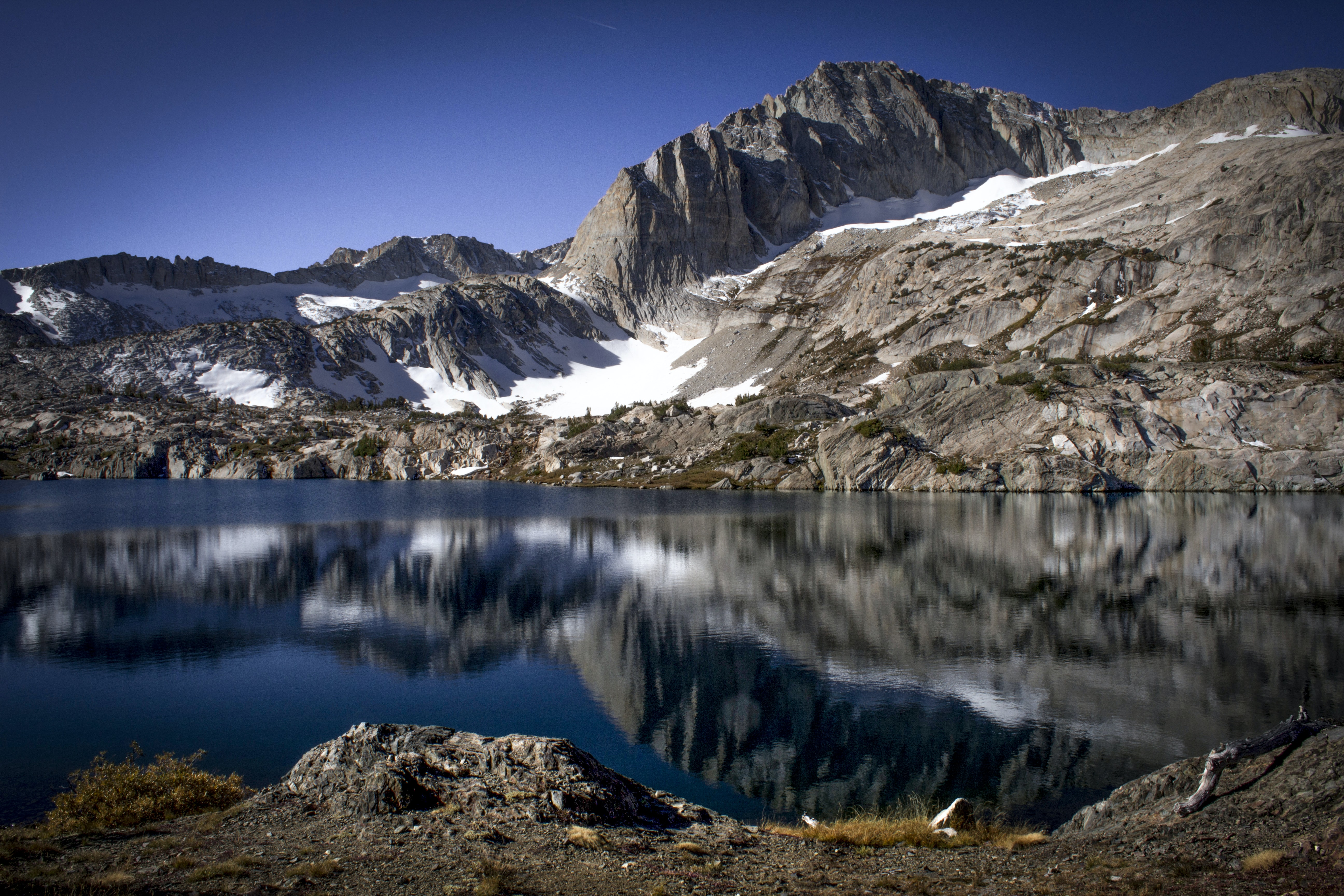 reflection photography of body of water and tundra mountain