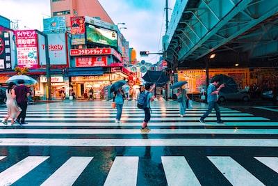 boy under black umbrella spectrum zoom background