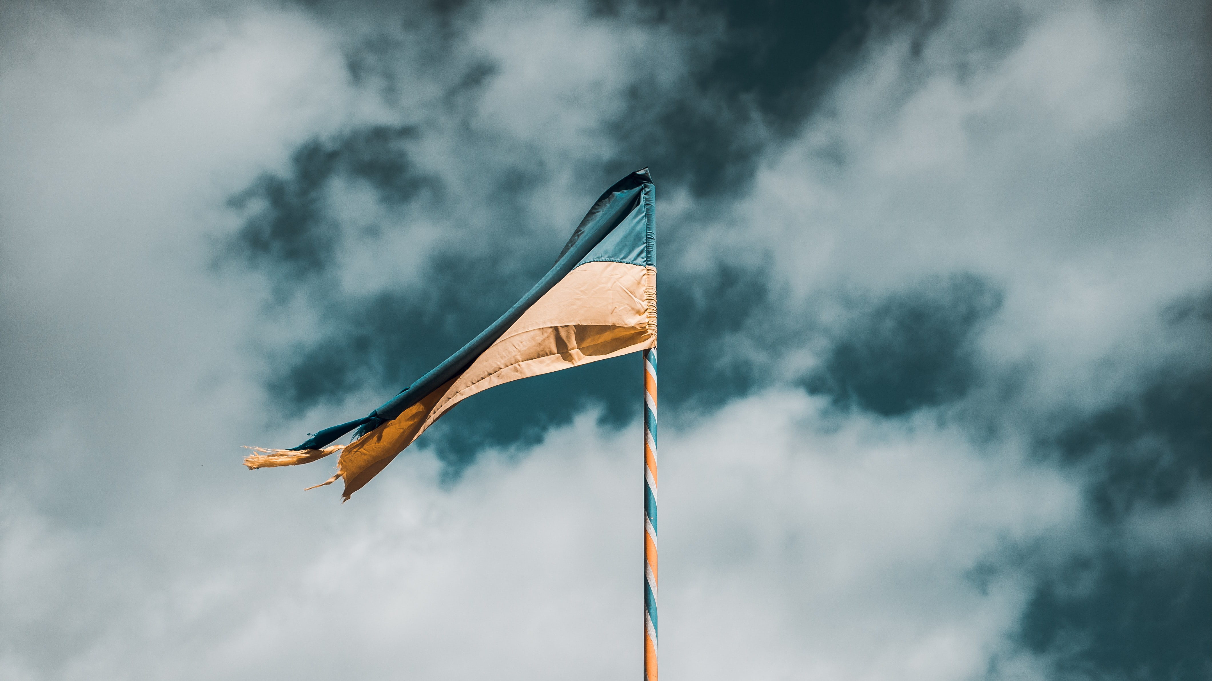 teal and yellow flag
