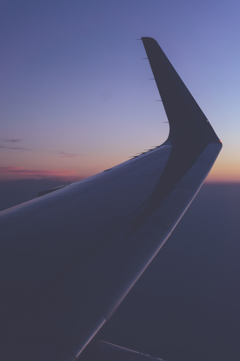closeup photography on airplane wing at golden hour
