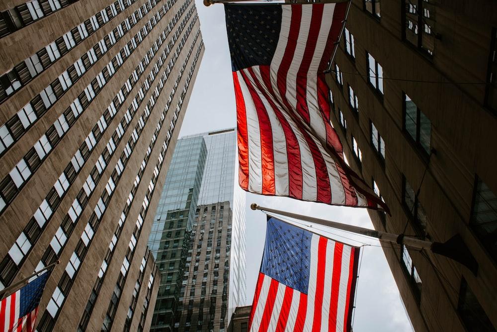 worm's eye view photography of USA flag on pole