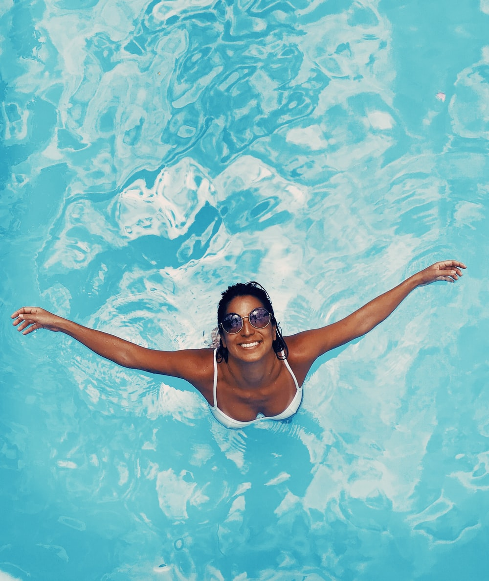 woman spreading her arms in body of water