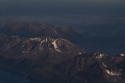 aerial photography of mountains moody teams background