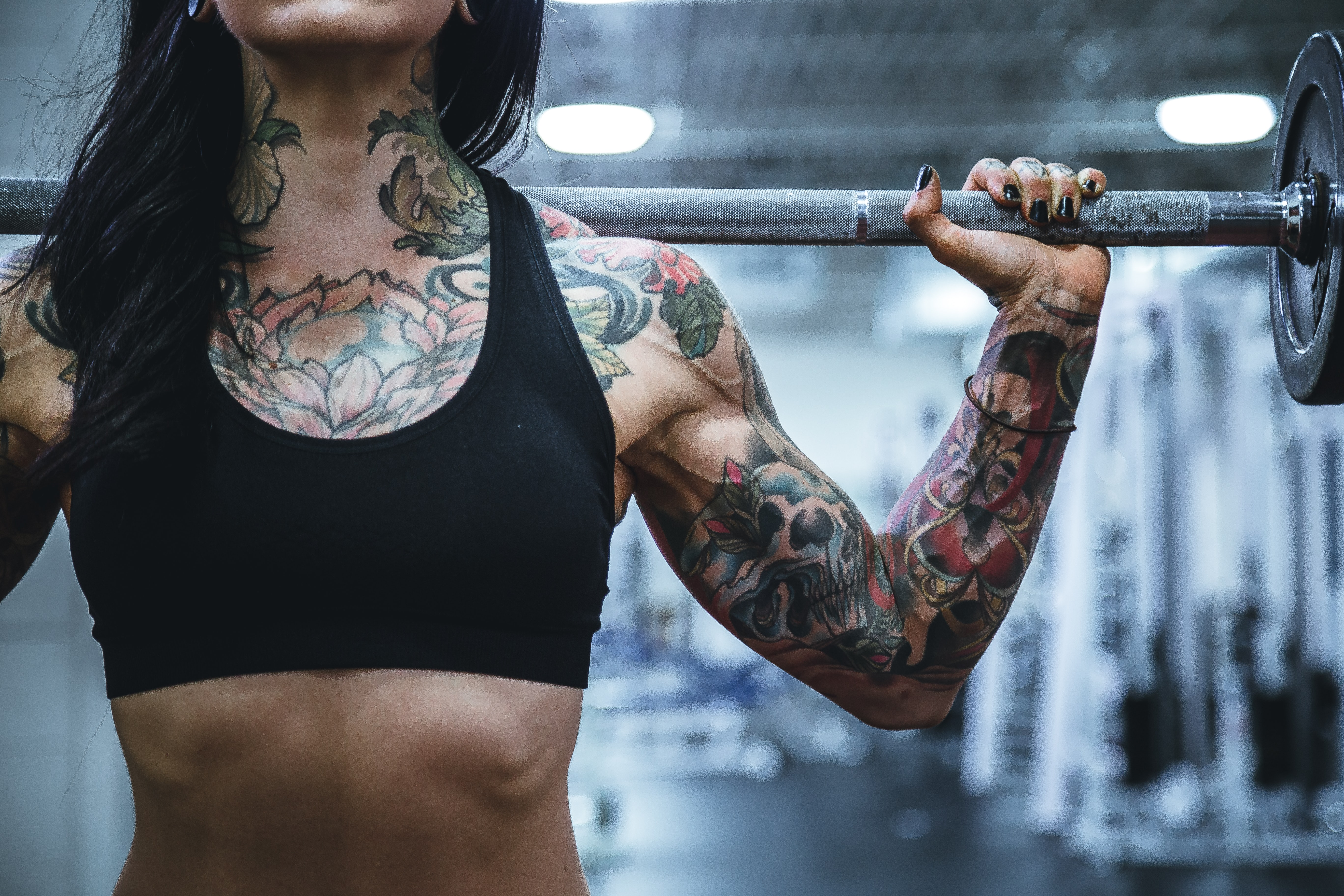 woman carrying barbell