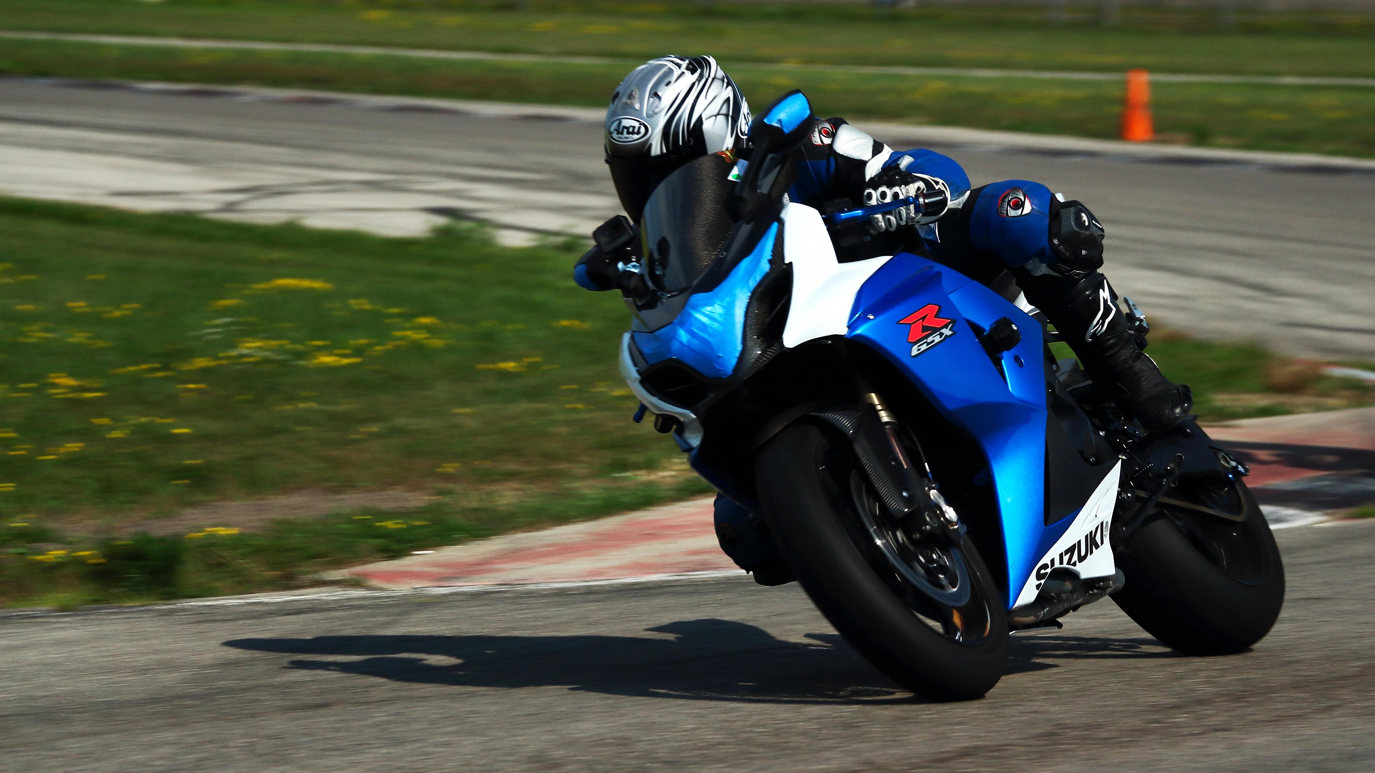 man wearing motor gear riding sport bike
