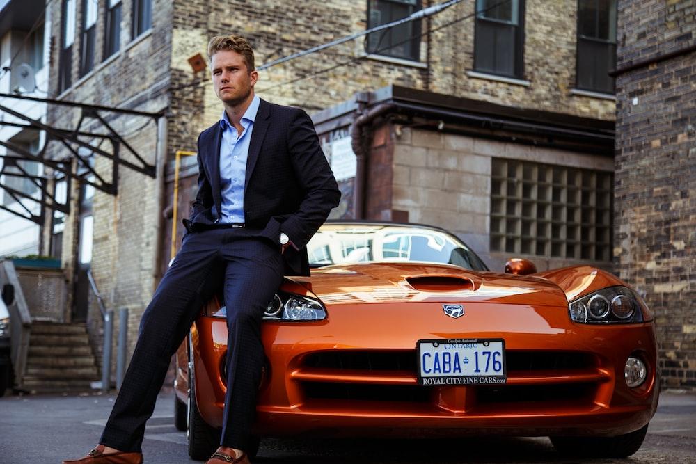 men's black suit and orange coupe