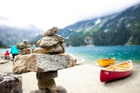 selective focus photography of cairn stone at daytime