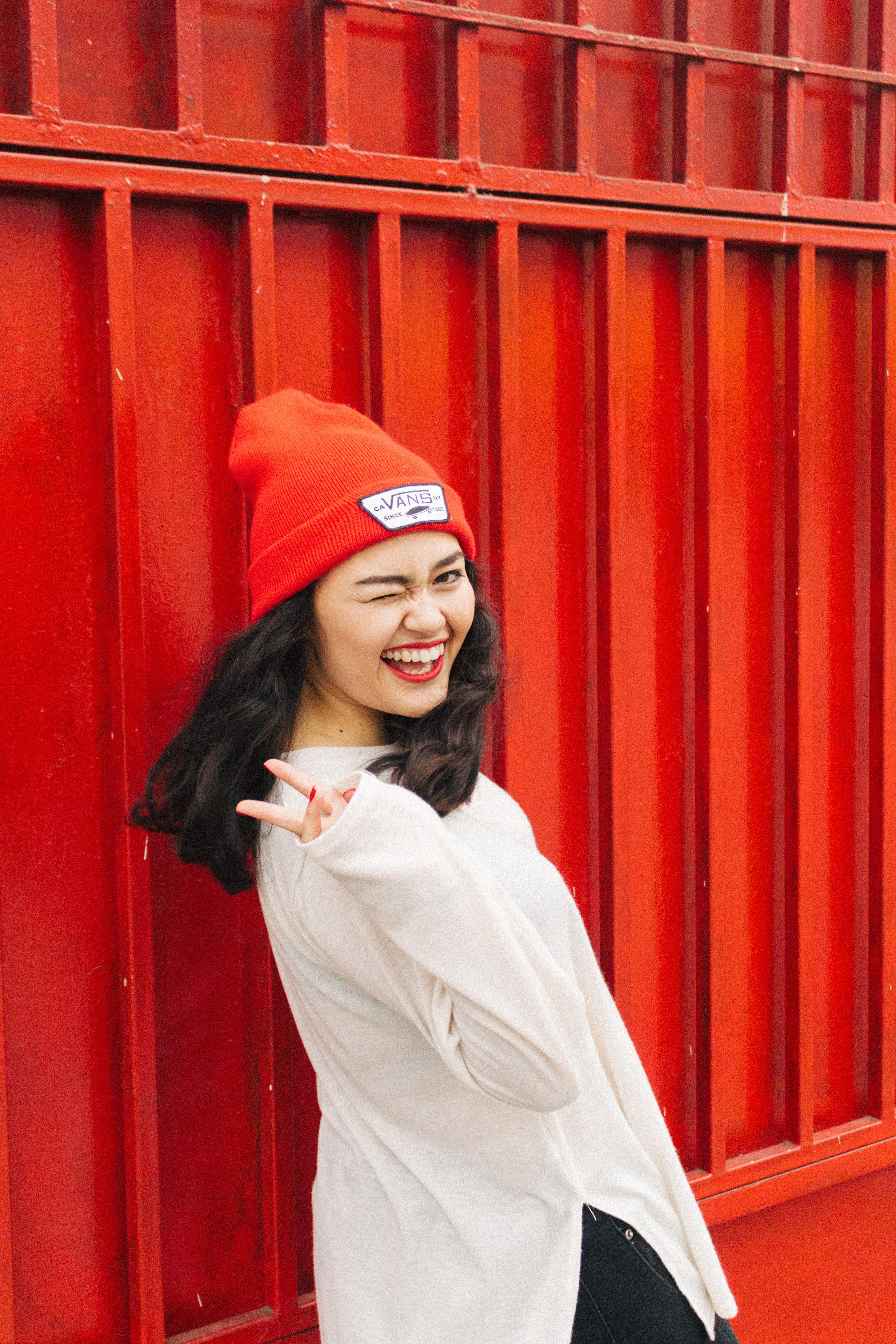 women's white long-sleeved shirt and red knitted cap