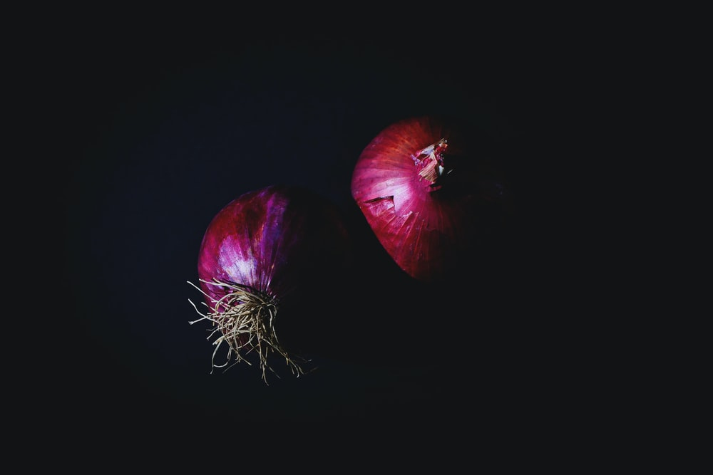 two red onion bulbs