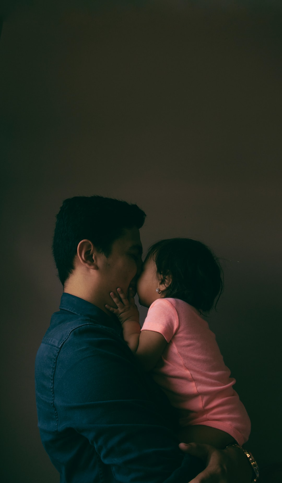 This picture is of my daughter Selah and me. I was doing a self portrait and she approached us to take a picture together, and the picture came out just at the time she gave me a kiss with a lot of love.