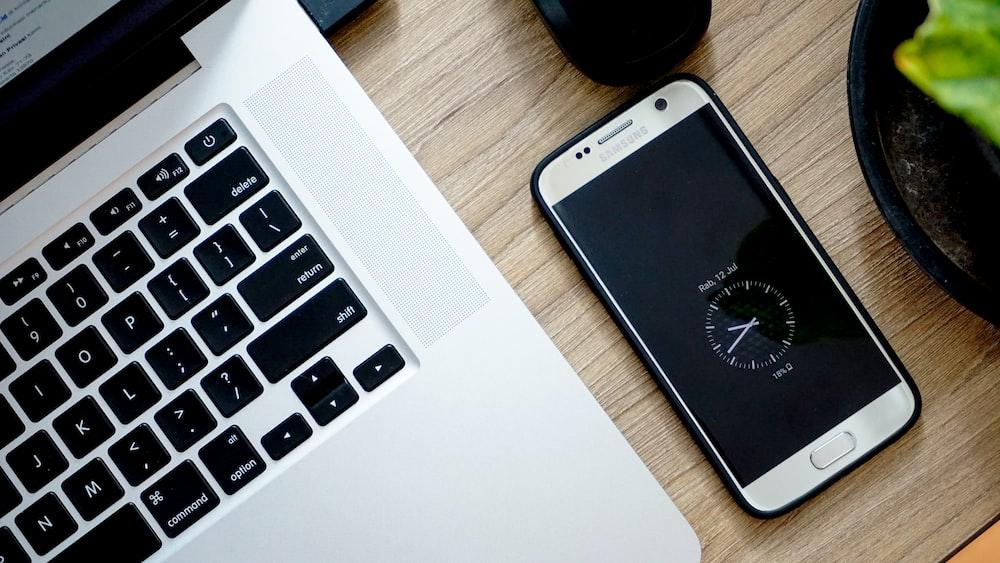 smartphone beside MacBook Pro