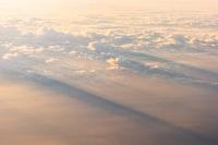 sun rays through white clouds